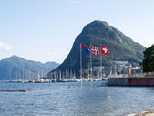 Lake Lugano, Monte San Salvatore ,and the flags of Switzerland,  — Stock fotografie