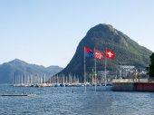 Lake Lugano, Monte San Salvatore ,and the flags of Switzerland,  — Stock Photo