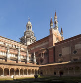 Cloister with views of the church's domes and spiers — Stock Photo