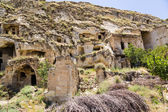 "Cappadocia, Turkey. ""Facades"" abandoned ""cave houses"" in the old town of Urgup — Stock Photo"