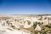 Cappadocia, Turkey. Mountain valley with pillars of weathering near Uchisar town — Stock Photo
