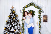 Mother and baby at winter background indoors — Stock Photo