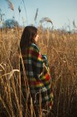 Girl basking in a plaid — Stock Photo