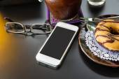 Smart Phone with glasses and donut — Stock Photo
