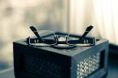Modern glasses on tissue box — Stock Photo
