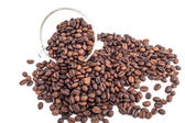 Transparent glass full of coffee beans — Stock Photo