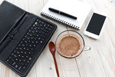 Tablet keyboard and cup of coffee — Stock Photo