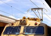 Overhead line of railway tracks and pantograph — Stock Photo