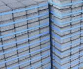 The construction of sidewalk bricks — Stock Photo