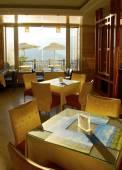 Morning sunlight through the breakfast room — Стоковое фото