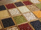 Closeup of seeds and grains in wooden box — Stock Photo