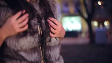 Beautiful woman in a fur and hat — Stock Video
