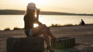 Beautiful woman relaxing on a beach — Stock Video