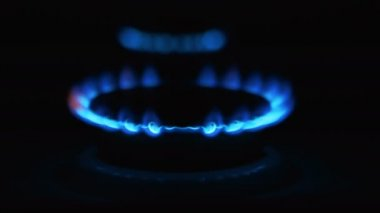 Gas stove with flames over it - on black background — Stock Video