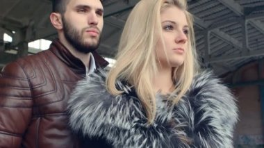Cold arms of young bearded men and beautiful blonde in fur — Stock Video