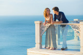 Couple posing on a balcony — Stock Photo