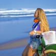 Surfer girl with a bicycle — Stock Photo #54787453