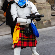 Постер, плакат: Street performer disguised as a kilted Star Wars stormtrooper