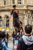 Street performer on the rope while playing the violin — Stock Photo