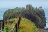 Dunnottar castle promontory and fence — Stock Photo