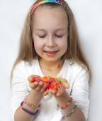 Loom bags craft Little girl demonstrating her works — Stock Photo