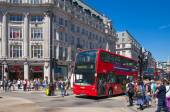 LONDON, UK - JULY 29, 2014: Regent street in London, tourists and busses — Stock Photo