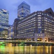 LONDON, UK - JUNE 14, 2014: Canary Wharf at dusk, Famous skyscrapers of London's financial district at twilight. — Stock Photo #54777355
