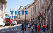 LONDON, UK - 22 JULY, 2014: Regent street named after Prince Regent, completed in 1825. Famous tourist destination and shopping point in London — 图库照片