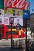 LONDON, UK - 22 JULY, 2014: People and traffic in Piccadilly Circus. Famous place for romantic dates. Square was built in 1819 to join to Regent Street — Stock Photo