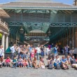 LONDON, UK - 22 JULY, 2014: Covent Garden market, one of the main tourist attractions in London, known as restaurants, pubs, market stalls, shops and public entertaining. — Stock Photo #55221631