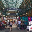 LONDON, UK - 22 JULY, 2014: Covent Garden market, one of the main tourist attractions in London, known as restaurants, pubs, market stalls, shops and public entertaining. — Stock Photo #55221811