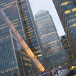 LONDON, UK - JUNE 14, 2014: Canary Wharf at dusk, Famous skyscrapers of London's financial district at twilight. — Stock Photo #55222953