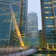 LONDON, UK - JUNE 14, 2014: Canary Wharf at dusk, Famous skyscrapers of London's financial district at twilight. — Stock Photo #55223133