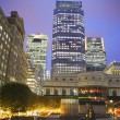 LONDON, UK - JUNE 14, 2014: Canary Wharf at dusk, Famous skyscrapers of London's financial district at twilight. — Stock Photo #55223677