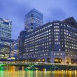 LONDON, UK - JUNE 14, 2014: Canary Wharf at dusk, Famous skyscrapers of London's financial district at twilight. — Stock Photo #55223775