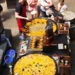 Paella in Covent Garden market, one of the main tourist attractions in London, known as restaurants, pubs, market stalls, shops and public entertaining. — Stock Photo #56860537