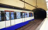 MADRID, SPAIN - MAY 28, 2014: Madrid tube station, train arriving on a platform — Stock Photo