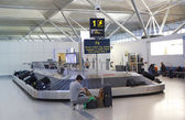 Stansted airport,  luggage waiting aria — Stockfoto