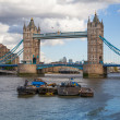 LONDON, UK - AUGUST 16, 2014: Tower bridge and river Thames South bank walk. — Stock Photo #58589195