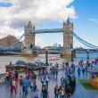 LONDON, UK - AUGUST 16, 2014: Tower bridge and river Thames South bank walk. — Stock Photo #58589273
