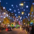 Black Friday weekend in London the first sale before Christmas. Oxford treet beautifully decorated with Christmas lights. Roads were open for pedestrians only — Stock Photo #59324089