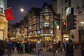 LONDON, UK - NOVEMBER 30, 2014: Black Friday weekend in London the first sale before Christmas. Regent street beautifully decorated with Christmas lights. Roads were open for pedestrians only — Stock Photo