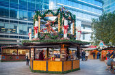 LONDON, UK - NOVEMBER 29, 2014 - Canary Wharf square, traditional fun fair with stools, cafe, prises to win and Christmas activity. — Stock Photo