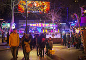 London, Leicester square traditional fun fair with stools, carrousel, prises to win and Christmas activity. People and families enjoying Christmas mood night out — Stock Photo