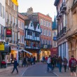 Постер, плакат: Trinity street with lots of shops and cafes Cambridge