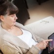Pension age good looking woman searching in internet on tablet device — Stock Photo #63031403