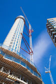 LONDON, UK - JULY 3, 2014: Building site with cranes on Canary Wharf aria, London. — Стоковое фото