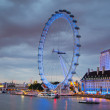London eye in the night and south bank of river Thames, famous London's walk and tourist destination — Stock Photo #64353471