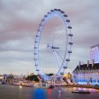 London eye in the night and south bank of river Thames, famous London's walk and tourist destination — Stock Photo #64353535
