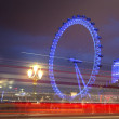 London eye in the night and south bank of river Thames, famous London's walk and tourist destination — Stock Photo #64353617